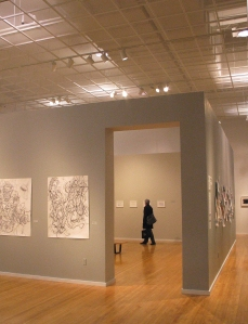 """Liz Leger's work on the left, we painted the """"cube"""" grey inside and out for this exhibition."""